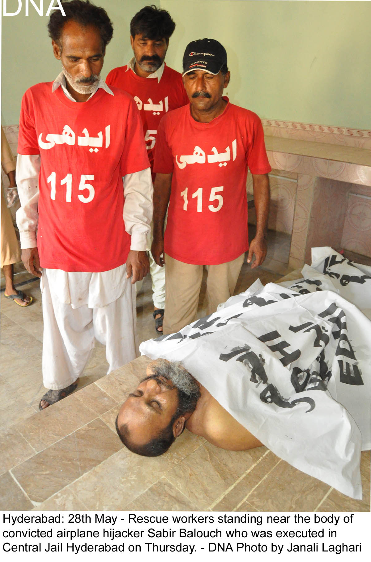 Hyderabad: 28th May - Rescue workers standing near the body of  convicted airplane hijacker Sabir Balouch who was executed in  Central Jail Hyderabad on Thursday. - DNA Photo by Janali Laghari