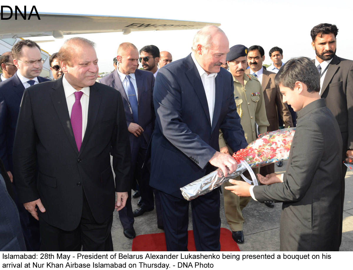 Islamabad: 28th May - President of Belarus Alexander Lukashenko being presented a bouquet on his  arrival at Nur Khan Airbase Islamabad on Thursday. - DNA Photo