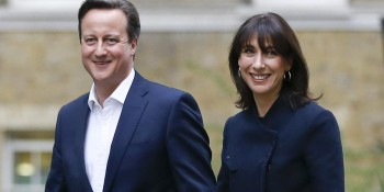 Britain's Prime Minister David Cameron and his wife Samantha smile as they return to 10 Downing Street in London, Friday, May 8, 2015.  The Conservative Party surged to a surprisingly commanding lead in Britain's parliamentary election, with returns Friday backing an exit poll's prediction that Prime Minister David Cameron would remain in 10 Downing Street.  (AP Photo/Kirsty Wigglesworth)