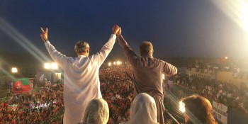Islamabad: 24th April - PTI leaders Jahangir Tareen and Shah Mehmood Qureshi wave hands to the  participants of 20th anniversary of PTI's foundation day celebrations. - DNA Photo