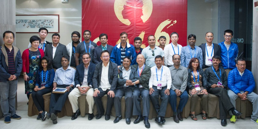 KUNMING, JUNE 17: Delegation of South Asian journalists in a group photo with Wang Lin, proprieter and other officials of China News Service (CNS) during their visit to the CNS Yunnan  province office. DNA PHOTO
