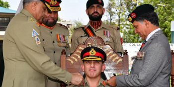 ABBOTTABAD, APR 30: Chief of Army Staff, Gen. Qamar Javed Bajwa, installing Lt. General Aamir Abbasi as Colonel Commandant of FF Regiment, on Tuesday.=DNA PHOTO