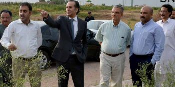 ISLAMABAD, JUN 17: Chairman CDA, Amer Ali Ahmed inspecting developmental work of Park enclave, on Monday.=DNA PHOTO