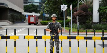 A Chinese People's Liberation Army (PLA) soldier guards the entrance to the PLA Hong Kong Garrison headquarters in the Central Business District in Hong Kong, China, August 29, 2019. REUTERS/Anushree Fadnavis