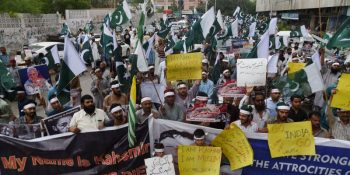 """Supporters of the Pakistani militant organisation Jamaat-ud-Dawa (JuD) take part in an anti-India protest rally in Karachi on August 5, 2019, in reaction to the move by India to abolish Kashmir's special status. - Pakistan on August 5 condemned India's move to abolish Kashmir's special status as """"illegal"""", insisting it was an internationally recognised disputed territory. (Photo by ASIF HASSAN / AFP)        (Photo credit should read ASIF HASSAN/AFP/Getty Images)"""