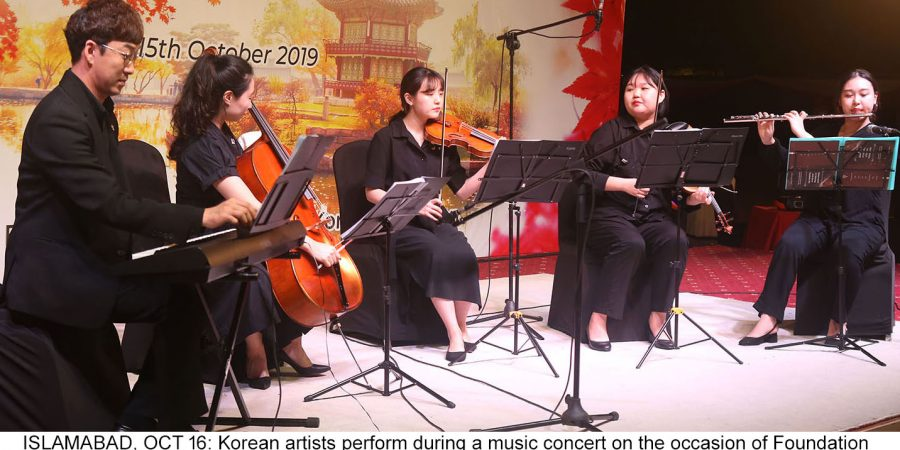 ISLAMABAD, OCT 16: Korean artists perform during a music concert on the occasion of Foundation Day of Korea.=DNA PHOTO