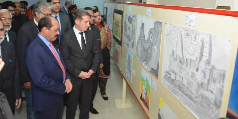 ISLAMABAD, JAN 20: Ambassador of Azerbaijan Ali Alizada and others witnessing an art  exhibition at  a local university on Monday. DNA PHOTO