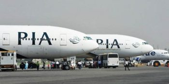 Pakistan International Airline (PIA) planes are positioned on the tarmac at the Benazir Bhutto International Airport in Islamabad on October 10, 2012. PIA have planed to reopen its flights for Swat valley which was shut down in 2007 due to the security situation.   AFP PHOTO/Farooq NAEEM
