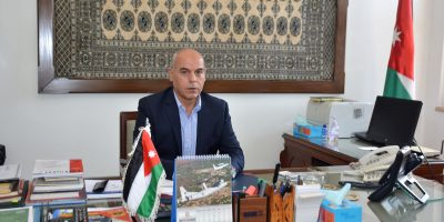 Ambassador of Jordan posing for a picture in his office