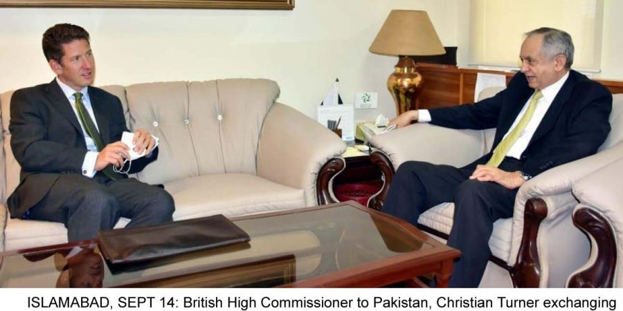 ISLAMABAD, SEPT 14: British High Commissioner to Pakistan, Christian Turner exchanging views with Federal Minister of Commerce Razaq Dawood on Monday.=DNA PHOTO