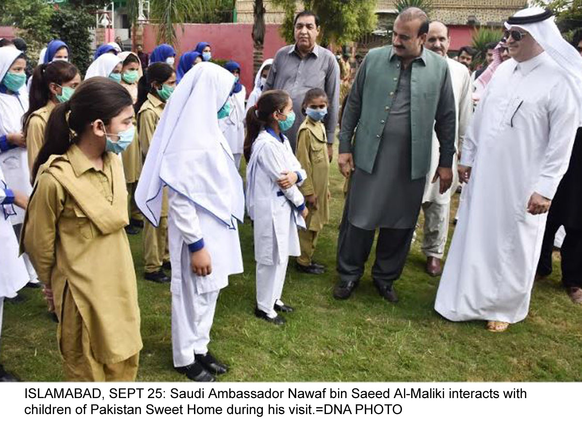 ISLAMABAD, SEPT 25: Saudi Ambassador Nawaf bin Saeed Al-Maliki interacts with children of Pakistan Sweet Home during his visit.=DNA PHOTO