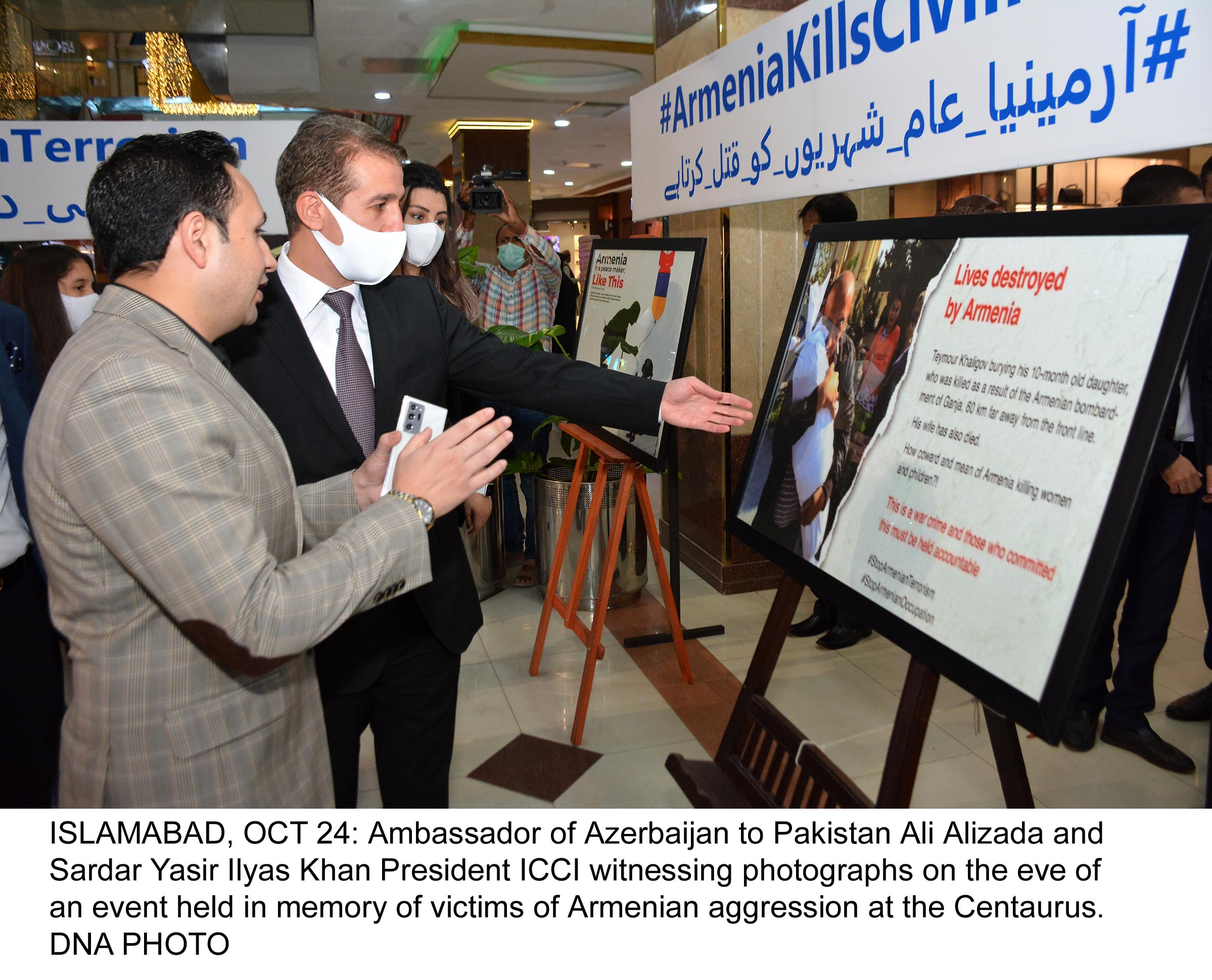 ISLAMABAD, OCT 24: Ambassador of Azerbaijan to Pakistan Ali Alizada and Sardar Yasir Ilyas Khan President ICCI witnessing photographs on the eve of an event held in memory of victims of Armenian aggression at the Centaurus. DNA PHOTO