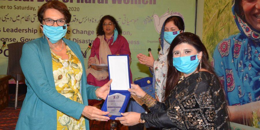 The EU Ambassador awarding rural women with shields